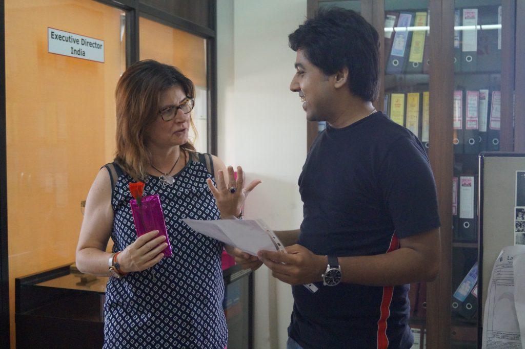 General Director, Ms. Alexandra Haglund, Mumbai Smiles felicitating Chiranshu (Volunteer) with a Certificate